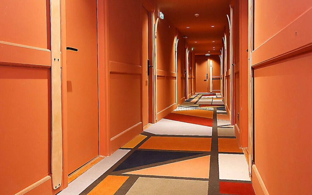 "Colourful custom-made corridor flooring in ""most exuberant hotel in"